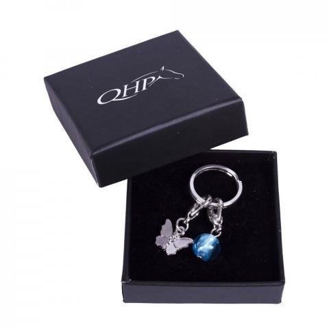 Brelok-przypinka do ogłowia QHP motyl srebrny z błękitną kulką